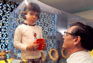 The bubble boy.  Born in 1971 with SCID, David Vetter lived in a sterile bubble to avoid outside germs that could kill him. He died in 1984 at 12 due to complications from a bone marrow transplant. [Credit: Baylor College of Medicine Archives]