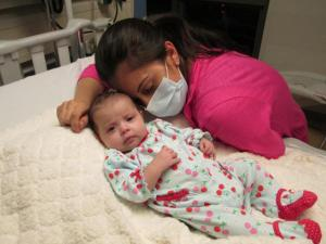 Alysia Padilla-Vacarro and daughter Evangelina on the day of her gene therapy treatment. Evangelina, now two years old, has had her immune system restored and lives a healthy and normal life. [Credit: UCLA Broad Center of Regenerative Medicine and Stem Cell Research.]