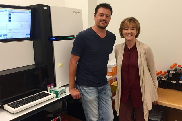 UCLA scientists David Casero and Gay Crooks with the sequencing machine that separated the genetic information within the bone marrow and thymus gland tissue stem cells. (Image credit: Mirabai Vogt-James, UCLA Broad Stem Cell Research Center)