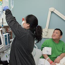 Aaron Kim with nurse. (City of Hope)