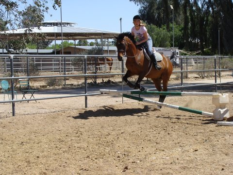 Kristin loves to ride horses.