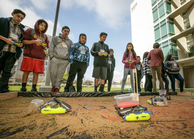 Students have fun with robots representing osteoblast and osteoclast cells at the Stem Cell Day of Discovery event held at the USC Health Sciences Campus in Los Angeles, CA. February 4th, 2017. The event encourages students to learn more about STEM opportunities, including stem cell study and biotech, and helps demystify the fields and encourage student engagement. Photo by David Sprague