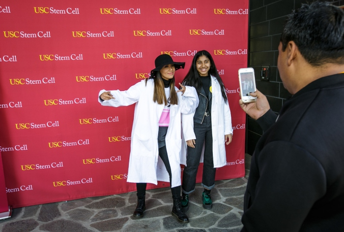 Genesis Archila, left, and Jasmine Archila get their picture taken at the Stem Cell Day of Discovery event held at the USC Health Sciences Campus in Los Angeles, CA. February 4th, 2017. The event encourages students to learn more about STEM opportunities, including stem cell study and biotech, and helps demystify the fields and encourage student engagement. Photo by David Sprague
